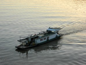 The boat being at an angle to the primary water ripples gives it more emphasis than if lined up.