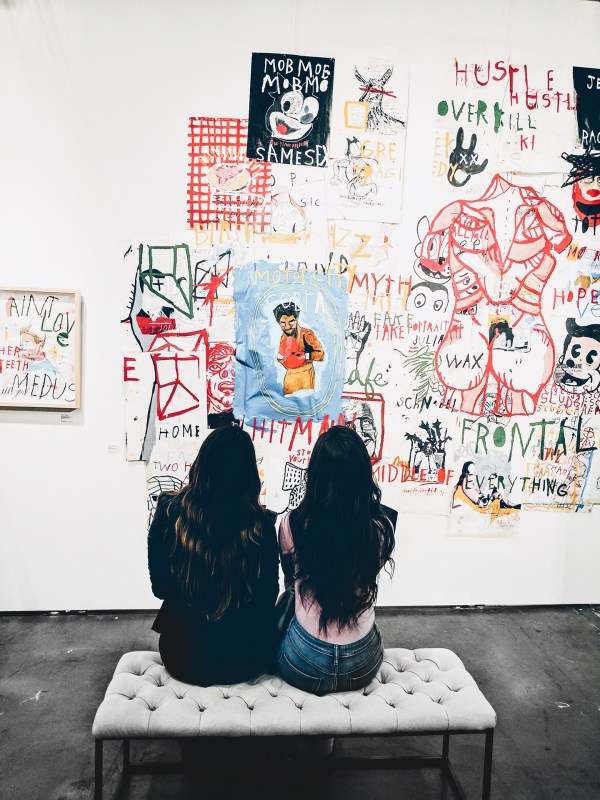 two girls looking at art