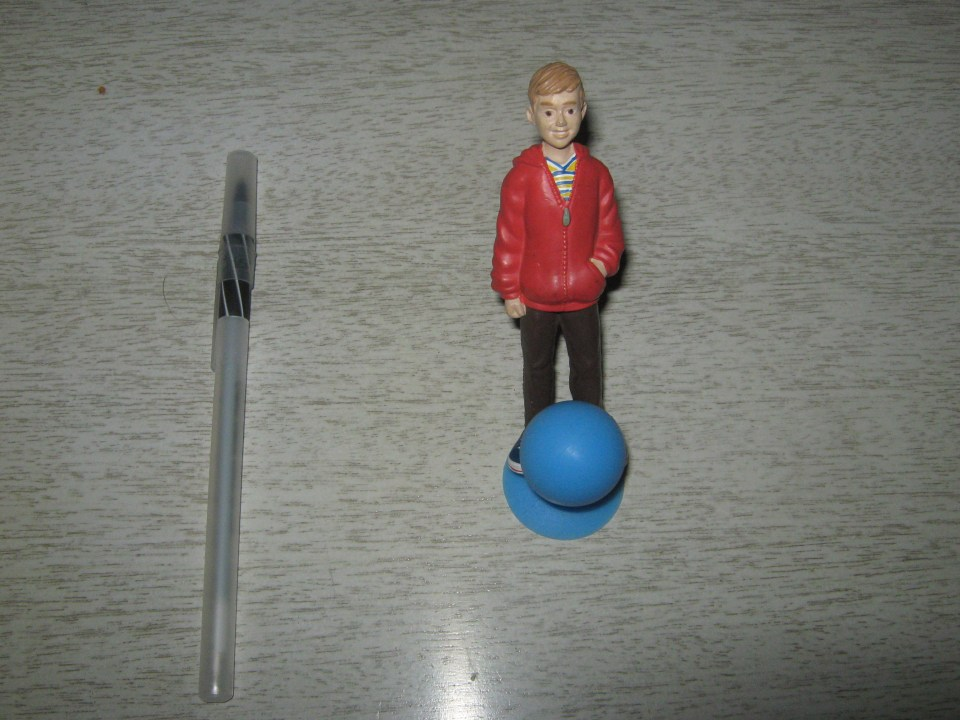 It's a creepy kid figure using the previous item in an unintended way! You're creepy, kid.