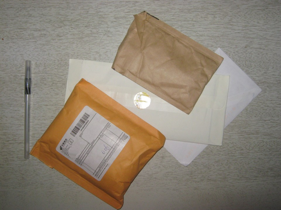 Two regular envelopes, two padded ones. Also a nice smiley face sticker that you can't see, because I still haven't learned how to work my camera!