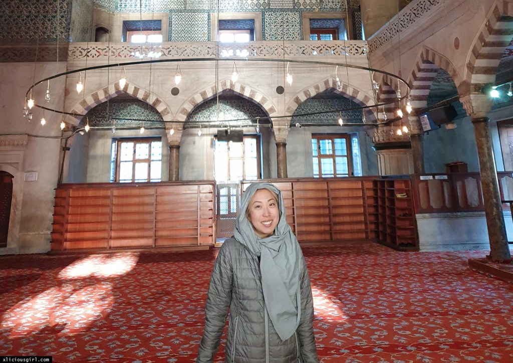 woman wearing a headscarf inside of a mosque