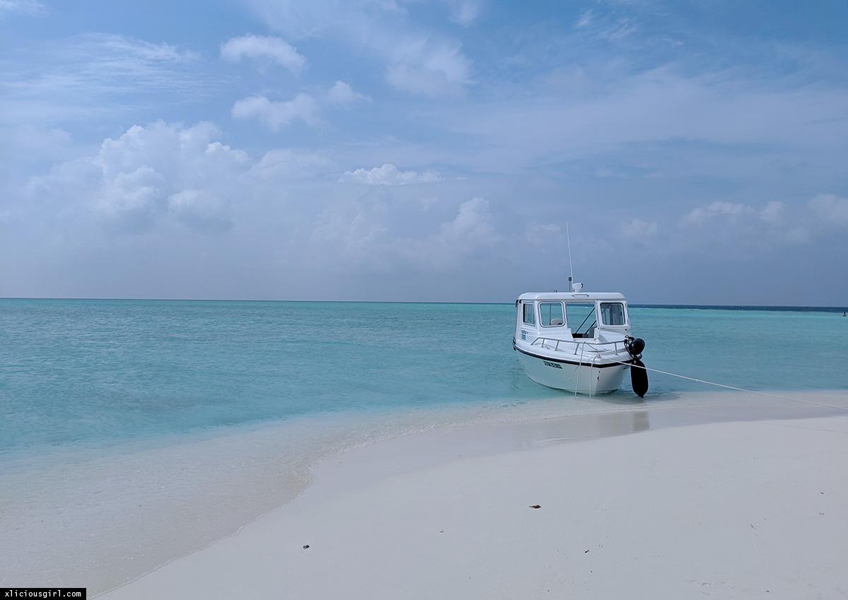 boat parked at the sandbank