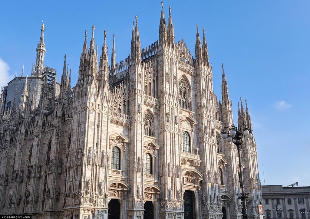front of Duomo di Milano church