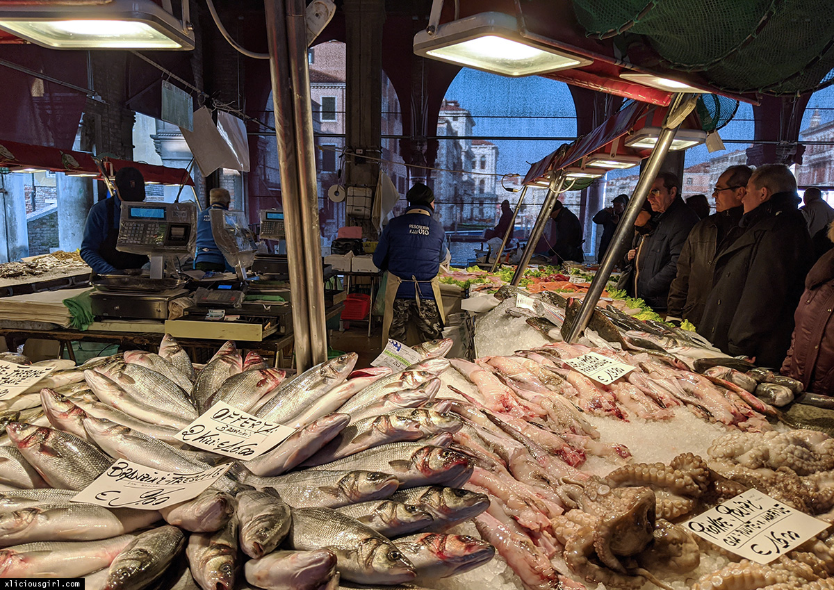 fresh fish being sold at a market