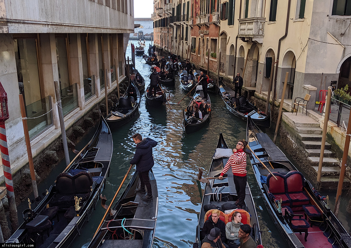 venice canal filled with gondolas