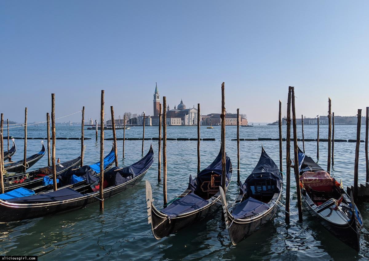 row of gondolas at ferry dock in venice