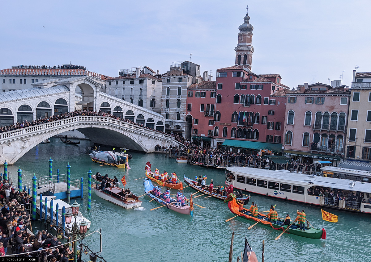 rialto bridge and colorful boats passing under it