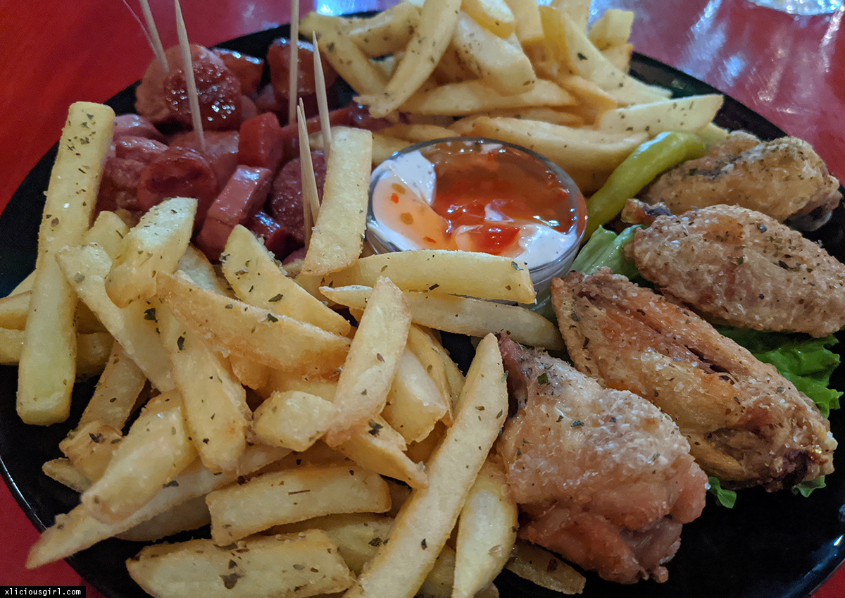 plate of french fries, chicken, and sausages