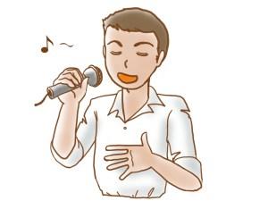 カラオケで歌いやすい曲を歌う男性
