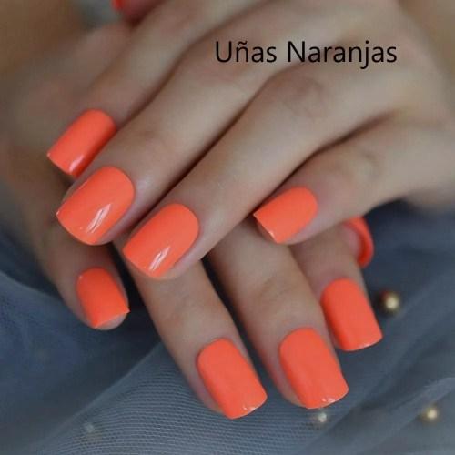 Uñas naranjas neón elegantes en moda