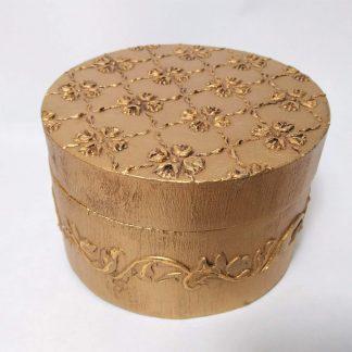 Caja redonda relieve dorado
