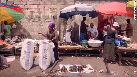 Bushmeat market in Kinshasa Port. Smoked fish is for sale here.