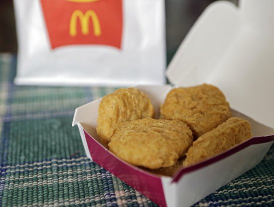 An order of McDonald's Chicken McNuggets is displayed for a photo in Olmsted Falls, Ohio Wednesday, March 4, 2015. McDonald's says it plans to start using chicken raised without antibiotics important to human medicine and milk from cows that are not treated with the artificial growth hormone rbST.. (AP Photo/Mark Duncan)