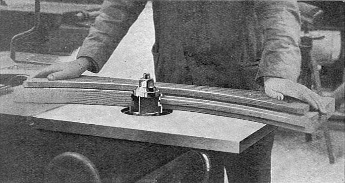 Curved_work_on_a_spindle_moulder_(Carpentry_and_Joinery,_1925)