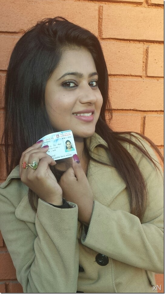 Keki Adhikari with her  card after voting