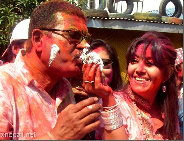karishma-offers-cake-to-binod-manandhar-holi