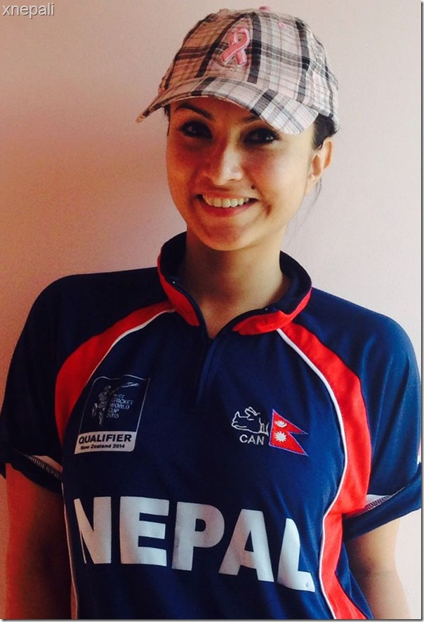 nisha adhikari wearing Nepali cricket team t shirt