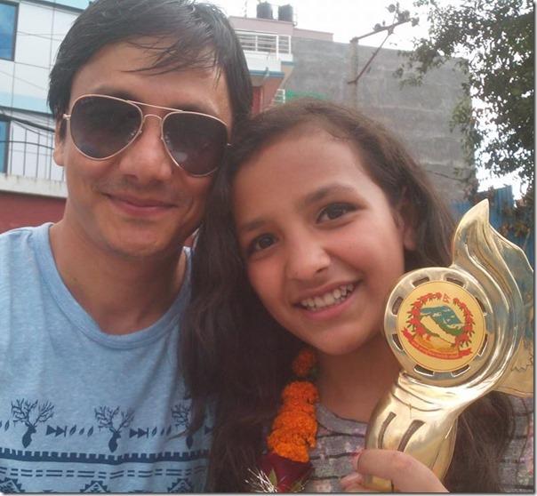 gajit bista with daughter after winnign national award