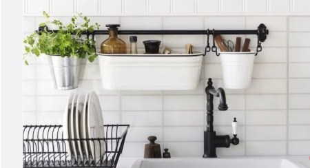 Small kitchen storage ideas for holding tools and opening up space.  I love this post so much! It seriously helped me so much! I live in a tiny place so I need to use every space so wisely! This guide gave me so many ideas and a lot of ways to think differently that I never thought about before. These simple home hacks for storage is amazing!! Pinning for later!