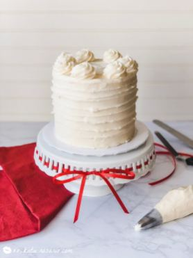 Red velvet layer cake is a popular flavor that's rich flavor and bright, vibrant color. Learn how these home baking tips and tricks are going to make cake decorating easier. Homemade Red Velvet is so much more than dyed chocolate or vanilla cake. This layered cake recipe is made from scratch and is full of flavor. #xokatierosario #redvelvetcake #homemaderedvelvetcake #redvelvetcakefromscratch #redvelvetcreamcheese