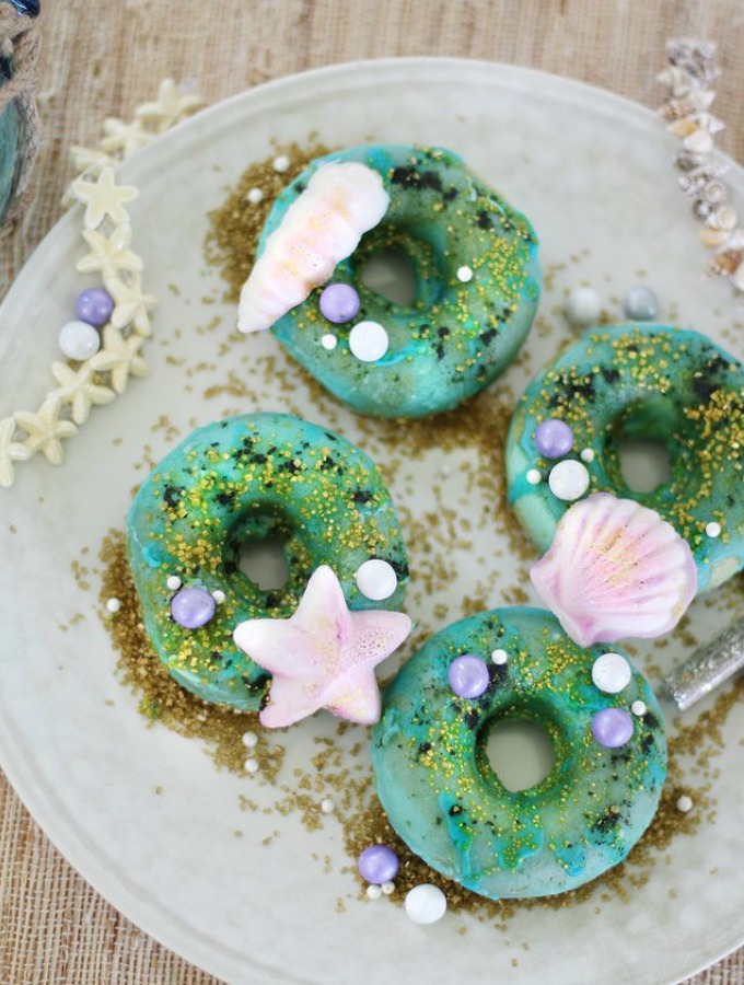 I love the mermaid trend that happening right now! The mermaid desserts are so bright and colorful and are simply magical! I think this post is a great idea because of the many recipes like mermaid cake pops, mermaid donuts, mermaid cookies and under the sea mermaid cakes! These treats will have everyone obsessing over your mermaid treats! This is a must try! #mermaidideas #mermaidcakes #mermaidtreats #mermaidparty #mermaiddesserts #diymermaid #DIYpartyideas #mermaidtail #underthesea