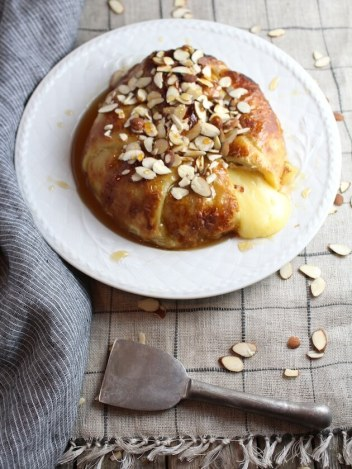 Baked Brie in Puff Pastry with Honey and Almonds | 15 Holiday Baked Brie Recipes For Easy Entertaining #bakedbrierecipes #holidayappetizers #easybakedbrie