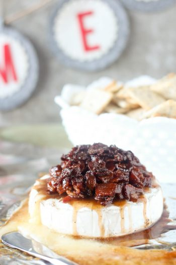 Candied Bacon Brie | 15 Holiday Baked Brie Recipes For Easy Entertaining #bakedbrierecipes #holidayappetizers #easybakedbrie