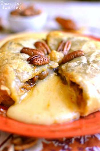 Pumpkin Pecan Baked Brie | 15 Holiday Baked Brie Recipes For Easy Entertaining #bakedbrierecipes #holidayappetizers #easybakedbrie