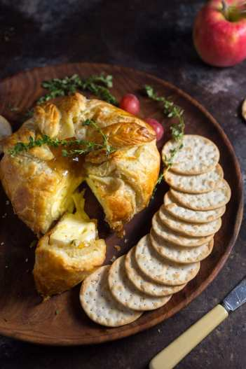 Baked Brie with Thyme and Fig | 15 Holiday Baked Brie Recipes For Easy Entertaining #bakedbrierecipes #holidayappetizers #easybakedbrie