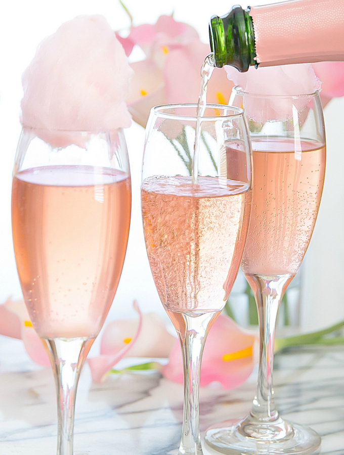 These Galentine's Day inspired cocktails are fun twists on classic cocktails that'll make your gal pal day festive! Choose from strawberry Moscow mules or homemade Frosé, cotton candy champagne or a pink senorita. These Galentine's day cocktails will elevate your next girls night! #xokatierosario #galentinesdaydrinks #girlsnightideas #girlsnightcocktails