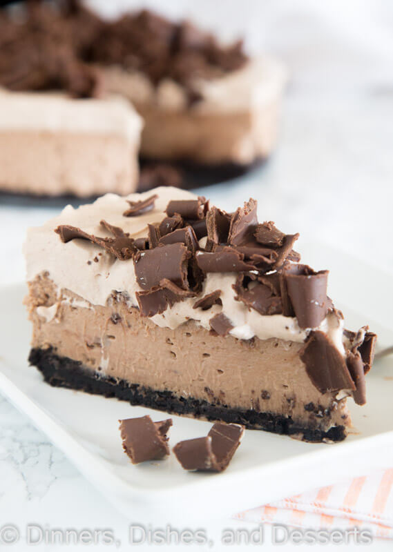 Bailey's Chocolate Cheesecake | Bailey's Irish Cream is an Irish dairy cream drink with chocolate and Irish whiskey, it's become a staple on St. Patrick's Day. It's easy to use Irish cream in dessert recipes because of its chocolate cream flavors. Bailey's Irish cream desserts are simple and delicious! #xokatierosario #baileysirishcream #irishcream #stpatricksdaydesserts