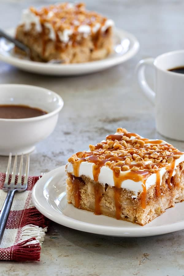 Caramel Apple Poke Cake | Poke Cakes make a foolproof, easy dessert every time. These poke cake recipes are quick and easy cakes that you need to try. It's a brilliant way to make delicious desserts every time because most of these poke cake recipe starts with simple store-bought ingredients, you see all the time and probably have in your kitchen already! #xokatierosario #pokecakerecipes #easypokecakerecipes #quickcakerecipes