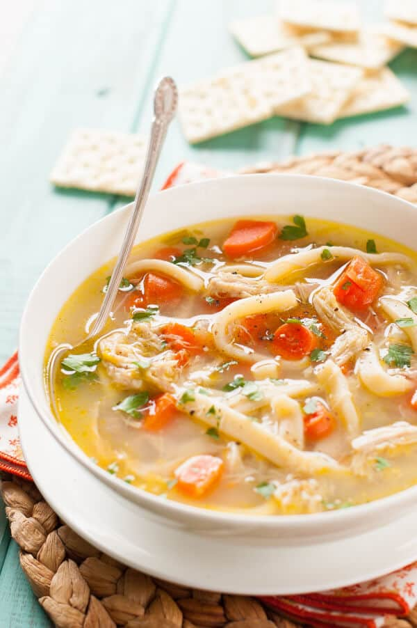 Crockpot Chicken Noodle Soup | Today we are looking at 16 clean eating dinners that'll take 30 minutes to make. It's nice to have some quick and easy clean eating recipes like these that you can refer back to. These healthy meals take 30 minutes so you can enjoy the rest of your night full and satisfied. #xokatierosario #cleaneatingdinnerrecipes #healthymeals #30minuterecipes