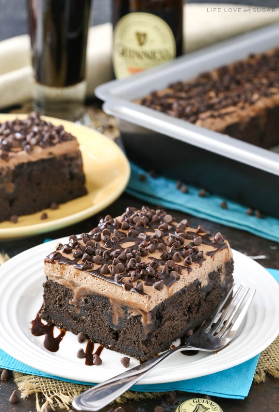 Guinness Chocolate Poke Cake | Poke Cakes make a foolproof, easy dessert every time. These poke cake recipes are quick and easy cakes that you need to try. It's a brilliant way to make delicious desserts every time because most of these poke cake recipe starts with simple store-bought ingredients, you see all the time and probably have in your kitchen already! #xokatierosario #pokecakerecipes #easypokecakerecipes #quickcakerecipes