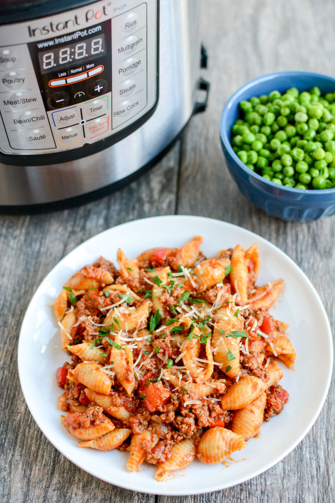 Instant Pot Pasta with Meat Sauce | Learn how to make easy pasta recipes you know and love in a one-pot wonder machine like the instant pot. These instant pot pasta recipes may seem too good to be true. With a little cleanup, you can have delicious soul-satisfying instant pot comfort food meals you can't wait to make. #xokatierosario #instantpotrecipes #instantpotpastarecipes #quickpastarecipes