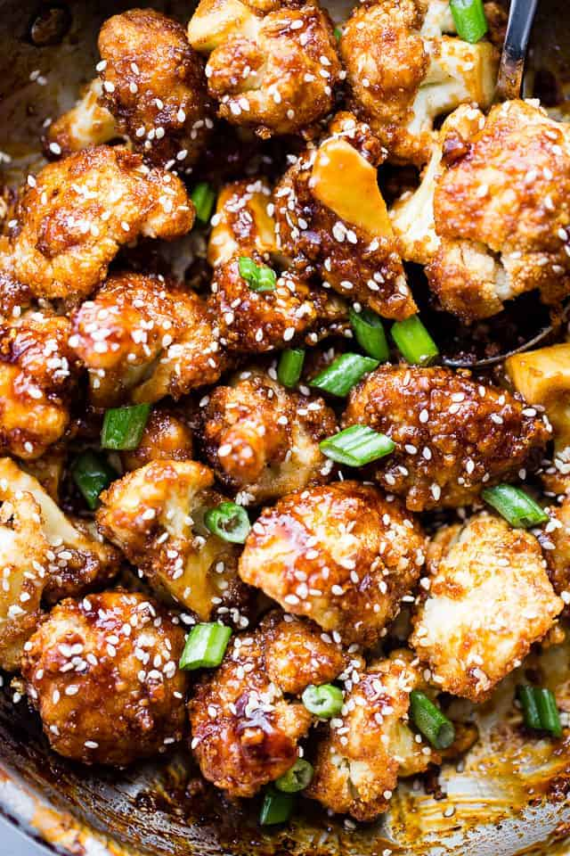 Sticky Sesame Cauliflower Bites   These cauliflower recipes can be a main dish or an excellent side dish. What I like most about cauliflower is how it can handle big bold flavors, like a lot of spices and sauces. It can be hearty for a vegetarian meal or a lightened version as a side dish. These healthy low carb cauliflower recipes will be a big hit with you and your family! #xokatierosario #easycauliflowerrecipes #healthycauliflowerrecipes #lowcarbcauliflower