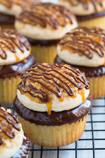 Samoa Cupcakes | Whether or not its Girl Scout Cookie season, these desserts are available all year round. Learn how to make dessert recipes inspired by your favorite Girl Scout Cookies. Turn the Girl Scout Cookies into pies, cheesecake or cupcakes. These GSC are super easy and totally craveable! Must check out! #xokatierosario #girlscoutcookies #girlscoutrecipes #girlscoutcopycat