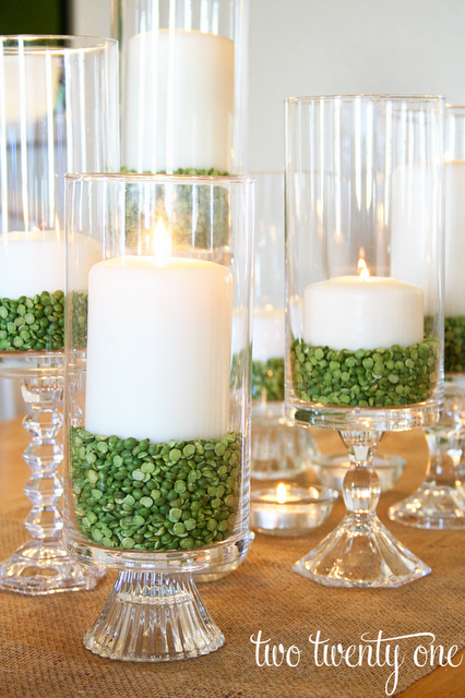 Thrifty Hurricane Candles | These adorable St. Patrick's Day decorations are perfect for a weekend of celebrating the lucky holiday. These DIY decorations will fit a great with your farmhouse rustic home decor while being festive at the same time! Choose from St. Patrick's inspired tablescapes, DIY signs, shamrock garlands or mini banners that work in desserts and centerpieces! #xokatierosario #stpatrickdaydecor #stpatricksdaydiycrafts #farmhousehomedecor