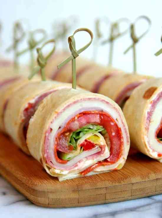 Italian Sandwich Roll Ups | These spring garden party recipes are light and refreshing and perfect for any outdoor entertaining. With the warmth of spring and all the flowers blooming throwing a garden party is the best way to embrace the new season. These simple garden party recipes are something anyone can make and impress your guests. #xokatierosario #springdinnerideas #gardenpartyfood #easypartyrecipes