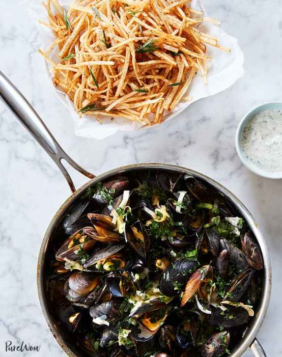 Mussels and French Fries   Learn how to make these traditional French recipes for yourself without taking hours or complicated techniques. These quintessentially French dishes are simple for every home cook to feel like a top chef. Here are 12 Classic French Dishes That'll Take One Hour or Less To Make! #xokatierosario #quickfrenchrecipes #frenchdishes #easyfrenchcooking
