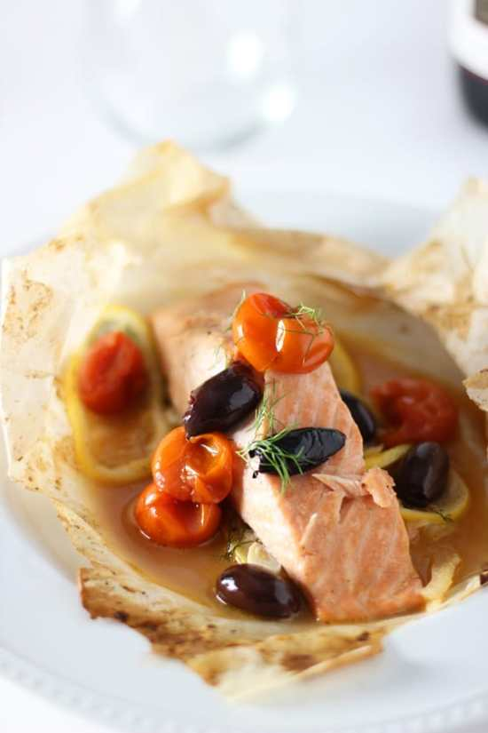 Salmon En Papillote | Learn how to make these traditional French recipes for yourself without taking hours or complicated techniques. These quintessentially French dishes are simple for every home cook to feel like a top chef. Here are 12 Classic French Dishes That'll Take One Hour or Less To Make! #xokatierosario #quickfrenchrecipes #frenchdishes #easyfrenchcooking