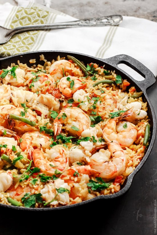 Spanish Seafood Paella | These spring garden party recipes are light and refreshing and perfect for any outdoor entertaining. With the warmth of spring and all the flowers blooming throwing a garden party is the best way to embrace the new season. These simple garden party recipes are something anyone can make and impress your guests. #xokatierosario #springdinnerideas #gardenpartyfood #easypartyrecipes