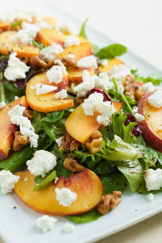 Goat Cheese Fresh Peach Salad with Candied Walnuts | These spring garden party recipes are light and refreshing and perfect for any outdoor entertaining. With the warmth of spring and all the flowers blooming throwing a garden party is the best way to embrace the new season. These simple garden party recipes are something anyone can make and impress your guests. #xokatierosario #springdinnerideas #gardenpartyfood #easypartyrecipes