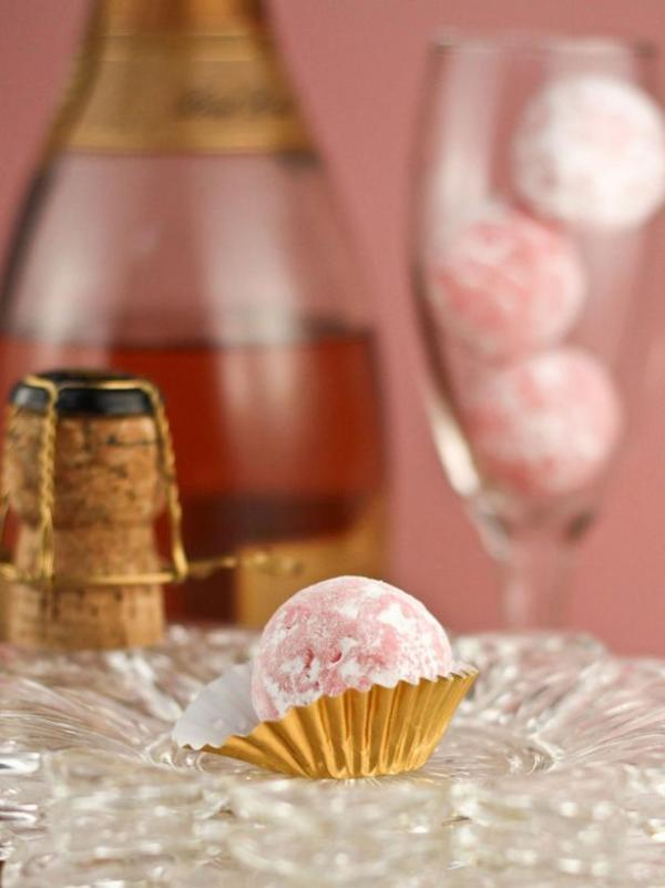 Pink Champagne Truffles | Champagne is a luxurious ingredient that elevates each dessert and makes them the star of the show. These desserts taste not only incredible like a glass of champagne but also look stunning. These Champagne desserts are rich and decadent and perfect for celebrating Mother's Day, Bridal Showers or just because it's the weekend! #xokatierosario #champagnedesserts #champagnerecipes #mothersdayrecipes