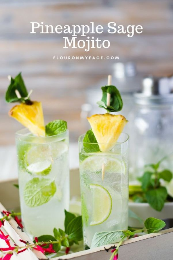 Pineapple Sage Mojitos | These sparkling drinks are fantastic for summer entertaining. Whatever sparkling drinks you choose to make this summer, your thirst will be quenched, and you'll stay relaxed and happy in the summer heat. Here are 14 Sparkling Drinks That'll Keep You So Refreshed! #xokatierosario #sparklingdrinks #sparklingcocktails #sparklingnonalcoholicdrinks #summerentertaining