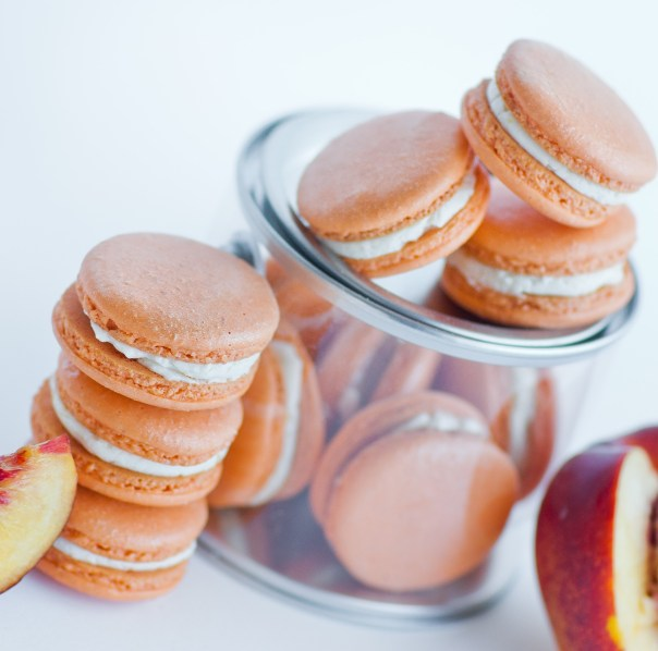 Champagne Peach Macarons | Champagne is a luxurious ingredient that elevates each dessert and makes them the star of the show. These desserts taste not only incredible like a glass of champagne but also look stunning. These Champagne desserts are rich and decadent and perfect for celebrating Mother's Day, Bridal Showers or just because it's the weekend! #xokatierosario #champagnedesserts #champagnerecipes #mothersdayrecipes