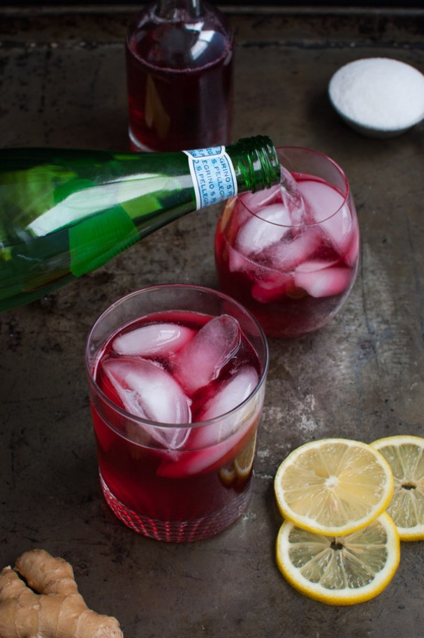 Hibiscus Tea Ginger Lemon Spritzer | These sparkling drinks are fantastic for summer entertaining. Whatever sparkling drinks you choose to make this summer, your thirst will be quenched, and you'll stay relaxed and happy in the summer heat. Here are 14 Sparkling Drinks That'll Keep You So Refreshed! #xokatierosario #sparklingdrinks #sparklingcocktails #sparklingnonalcoholicdrinks #summerentertaining