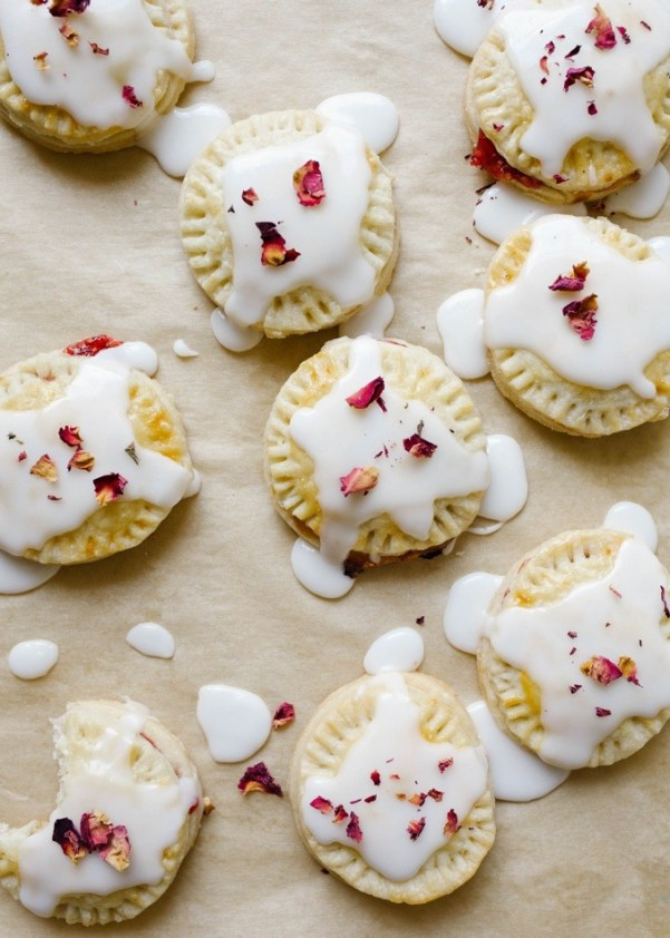 Raspberry Champagne Pop Tarts | Champagne is a luxurious ingredient that elevates each dessert and makes them the star of the show. These desserts taste not only incredible like a glass of champagne but also look stunning. These Champagne desserts are rich and decadent and perfect for celebrating Mother's Day, Bridal Showers or just because it's the weekend! #xokatierosario #champagnedesserts #champagnerecipes #mothersdayrecipes