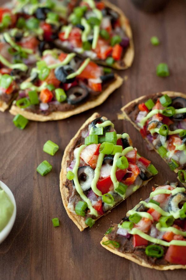 Skinny Mexican Pizza | Cinco de Mayo is fast approaching, and these easy appetizers are totally perfect for the Spring Holiday! You can choose from Mexican street corn salad, scallop ceviche, white queso dip, and even churros served with a warm chocolate espresso dipping sauce. No matter what you decide to make, you'll love any of these easy Cinco de Mayo appetizers! #xokatierosario #cincodemayo #easyappetizers #cincodemayorecipes