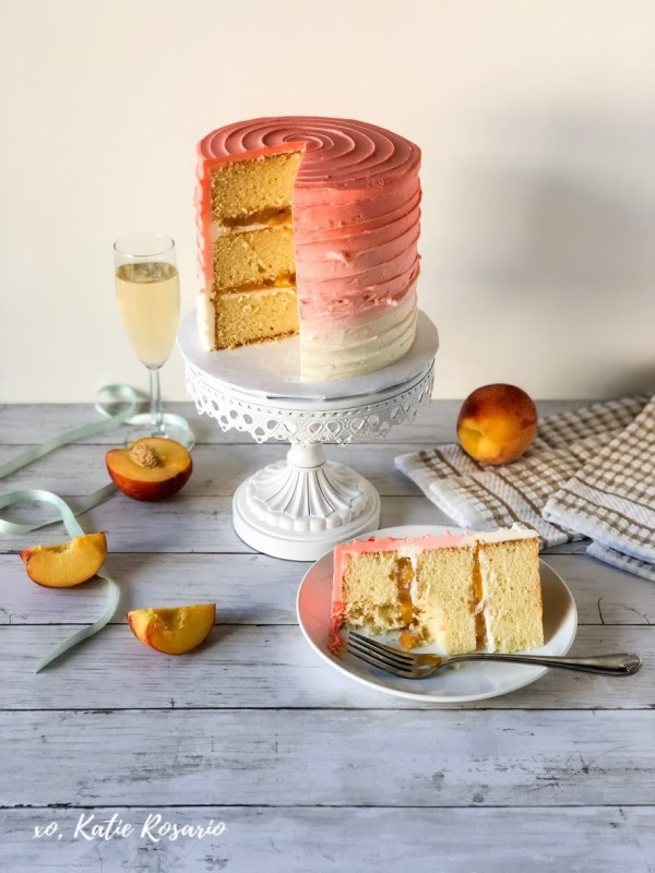 Looking for something fun and sweet this summer, celebrate with this peach bellini cake! It's perfect for a girls night out or a Sunday brunch! This peach bellini cake is made from a fluffy homemade champagne cake filled with peach filling, and peach champagne buttercream. This peach bellini cake is great for beginner bakers. #xokatierosario #peachbellinicake #peachcakerecipe #easypeachcake #peachchampagnecake